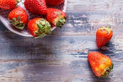 Ripe organic strawberries on wooden background, close up. Royalty Free Stock Images