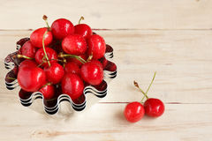 Red ripe juicy sweet cherry lies on vintage wooden background. Sweet summer berries. Royalty Free Stock Photos