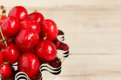 Red ripe juicy sweet cherry lies on vintage wooden background. Sweet summer berries. Stock Photography