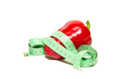 Red ripe pepper and sartorial meter on a white Stock Photography