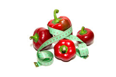 Red ripe peppers and sartorial meter on a white Royalty Free Stock Photography