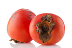 Red ripe persimmons Stock Photo