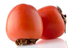 Red ripe persimmons Stock Photos