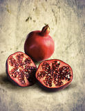 Red ripe pomegranate. On brown mottled background Royalty Free Stock Photos
