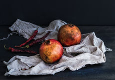 Red ripe pomegranate with spices on dark background Royalty Free Stock Photo