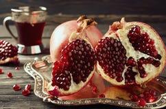 Red ripe pomegranate. Toned photo Royalty Free Stock Image