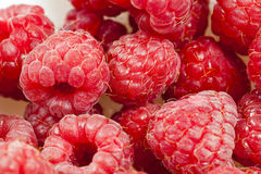 Red ripe raspberries. Harvest red ripe wild raspberries. The photo was taken close-up, small depth of field. Berries are in a pile on a wooden surface Royalty Free Stock Photos