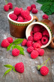 Red ripe raspberries on a wooden background. Red ripe raspberries on a old wooden background Royalty Free Stock Images