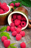 Red ripe raspberries on a wooden background Stock Photos