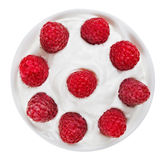 Red ripe raspberry fruit in plate with sour cream Royalty Free Stock Photo