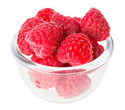 Red ripe raspberry fruit in transparent glass Royalty Free Stock Photography