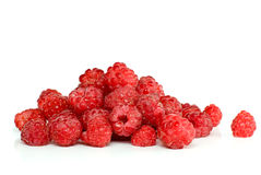 Red ripe raspberry pile. Isolated on the white background Stock Images