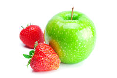 Red ripe strawberries and apple Royalty Free Stock Image