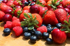 Red Ripe Strawberries, Blueberries, cherries and raspberries. Beautiful pile of red and ripe berries: strawberry, cherry, blueberry and raspberry fruit stock photography