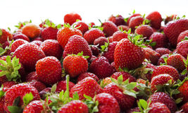 Red ripe strawberries tumbling, close up. Stock Image