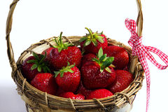 Red ripe strawberries in a wooden wicker basket Stock Photos