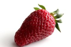 Red ripe strawberry close-up. Isolated on white background stock images