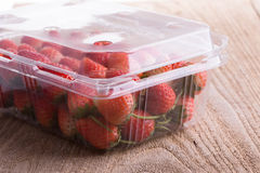 Red ripe strawberry in plastic box of packaging Royalty Free Stock Photos