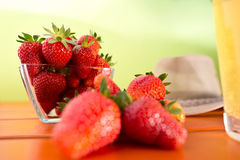 Red ripe strawberry on the table Stock Images