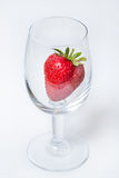 Red and ripe strawberry in wineglass on a white background Royalty Free Stock Image