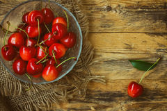 Red ripe a sweet cherry in bowl, canvas cloth Stock Images