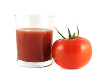 Red ripe tomato with glass of tomato juice Royalty Free Stock Image