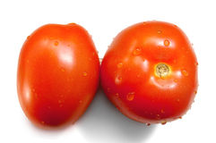 Red Ripe Tomatoes. Top and side view of red tomatoes with water droplets stock photography