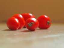 Red Ripe Tomatoes Arranged on Wooden Background. In Sunny Day Royalty Free Stock Image