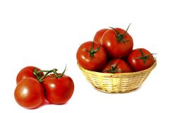 Red ripe tomatoes in a basket on a white background royalty free stock photography