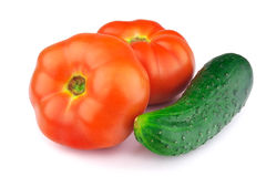 Red ripe tomatoes and cucumber Stock Photos