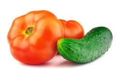 Red ripe tomatoes and cucumber Royalty Free Stock Image