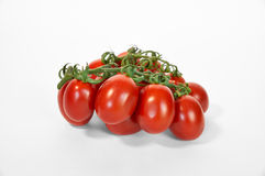 Red ripe tomatoes on green line close up white Stock Photo
