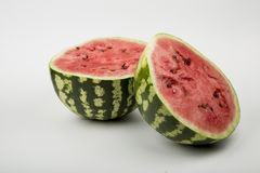 Red ripe watermelon. Juicy red ripe watermelon cut into two parts Royalty Free Stock Photo