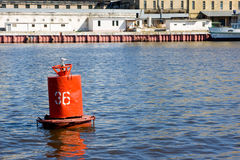 Red river buoy floating Royalty Free Stock Images