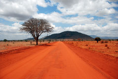 A red Road. In Tsavo-West National park / Kenia Stock Image