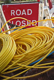 Red road closed sign yellow tubing cable Stock Photography