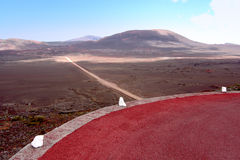 Red road crossing a volcano Royalty Free Stock Photo