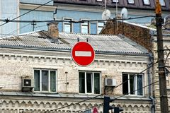 Red road sign prohibiting travel on the background of houses Royalty Free Stock Photo