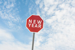 Red road sign with a text of new year under sky Royalty Free Stock Image