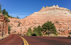Red road through Zion National Park Royalty Free Stock Images