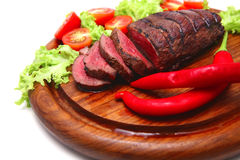 Red roast meat on wooden plate Royalty Free Stock Photos