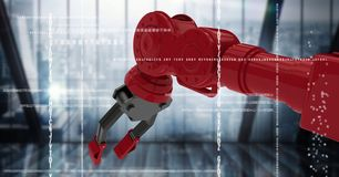 Red robot claw holding phone behind white interface against dark blurry window Royalty Free Stock Images