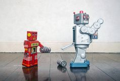 Free Red Robot Helping Big Silver Robot Stock Image - 156216361