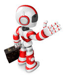 Red robot the right hand guides and the left hand is holding Stock Photo
