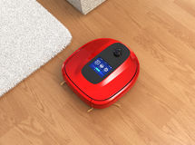 Red robotic vacuum cleaner moving on flooring Stock Image
