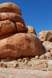 Red rock. Devil Marbles - red stones formation in Aussie outback Stock Photography