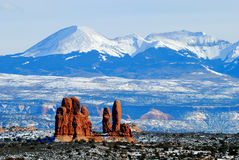 Red Rock against Snow Capped Mountain royalty free stock photography