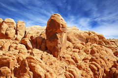 Red rock balanced. Rock balanced on an orange sandstone cliff Stock Image
