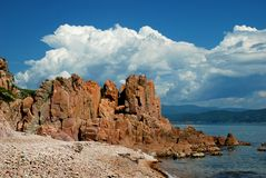 Red rock on the beach Royalty Free Stock Images