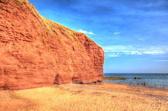 Red Rock beach Dawlish Warren Devon England on a summer day in HDR Royalty Free Stock Images
